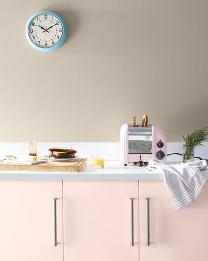A pale kitchen with pink cabinets painted with Benjamin Moore's 2020 Colour of the Year